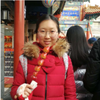 Jing stands in a food market.