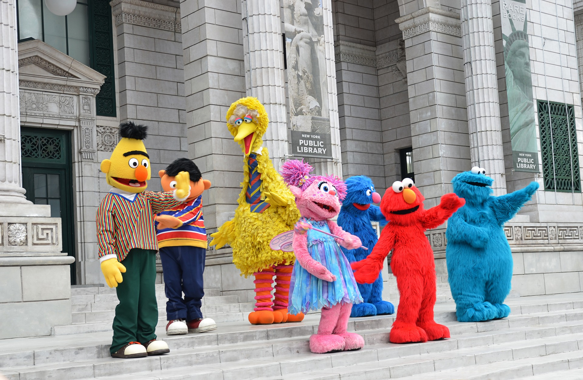Many Sesame Street characters in a group.